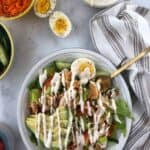 buffalo chicken salad with ranch drizzled on top