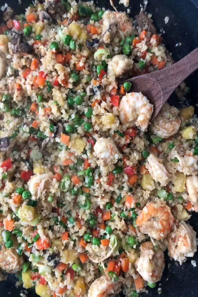 cauliflower and shrimp fried rice in cast iron skillet