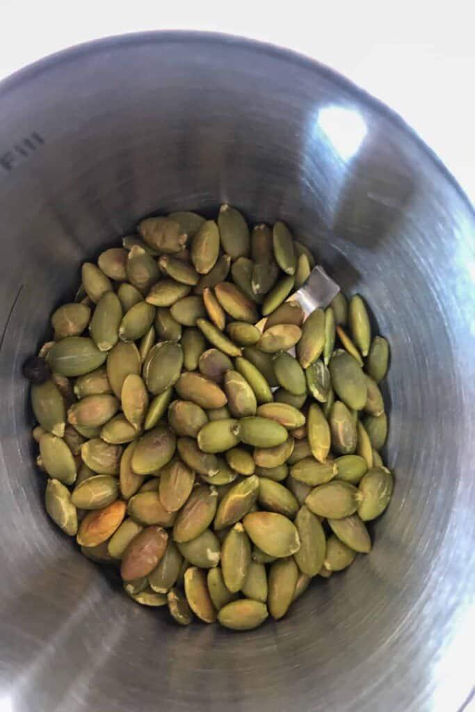 toasted pumpkin seeds in grinder