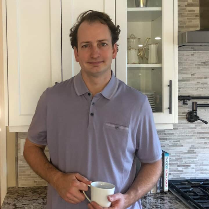 holding a coffee cup in my kitchen