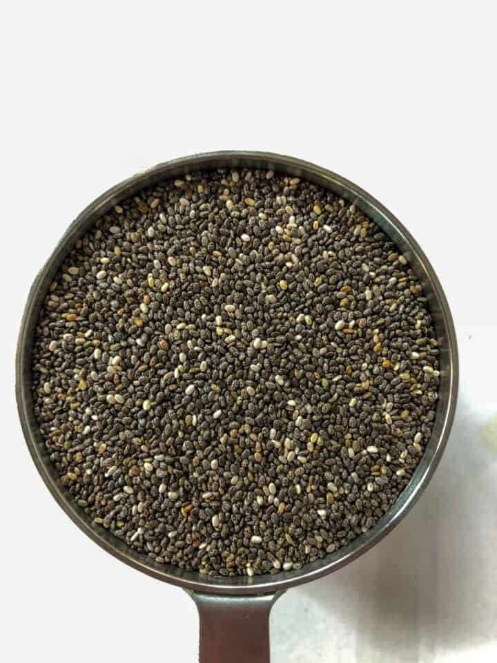 chia seeds in a dry measuring cup