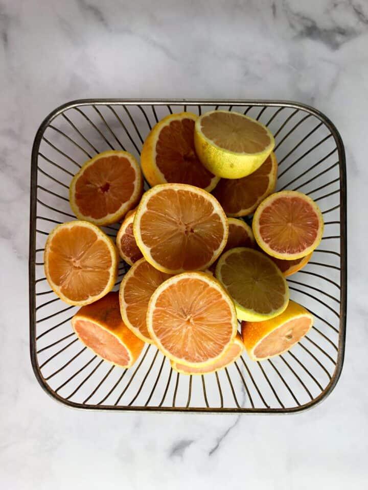 homemade lemonade hibiscus popsicles bowl of lemons cut in half