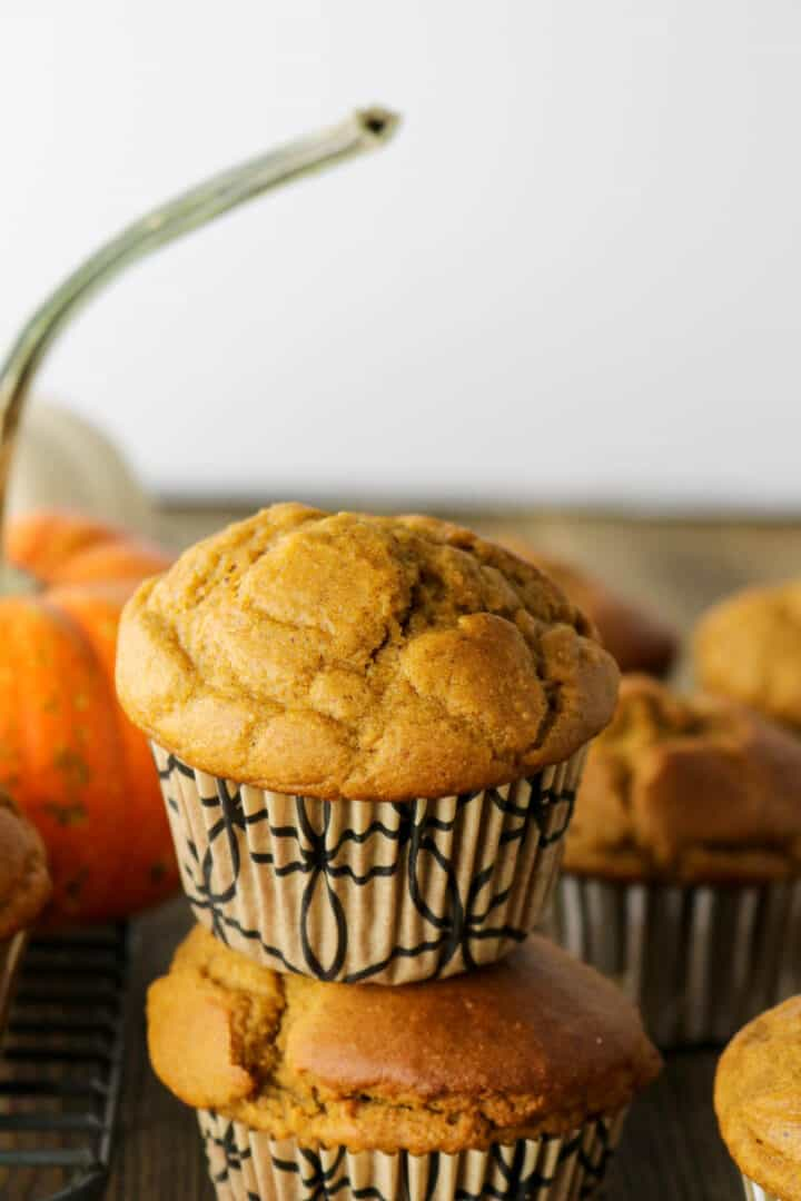 healthy pumpkin muffins stacked tall